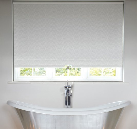 An image showing a freestanding bath tub in a modern bathroom with waterproof roller blinds