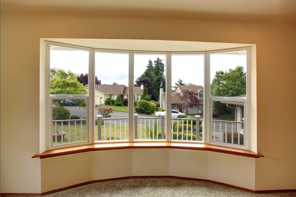 Bay windows overlooking a street - perfect for vertical blinds